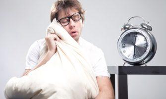 Sleeping man with big clock